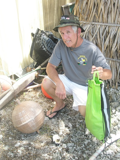 Paul Maley with a metallic sphere that is actually a float. Found in Tarawa, Republic of Kiribati May 11, 2013.